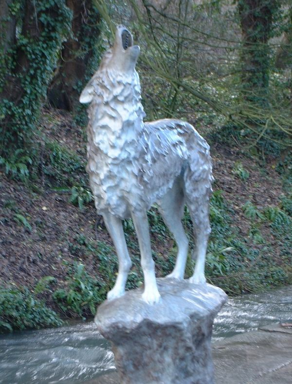 'Grey Wolf on a Rock (bronze standing Baying life size yard sculptures)' by Gill Parker